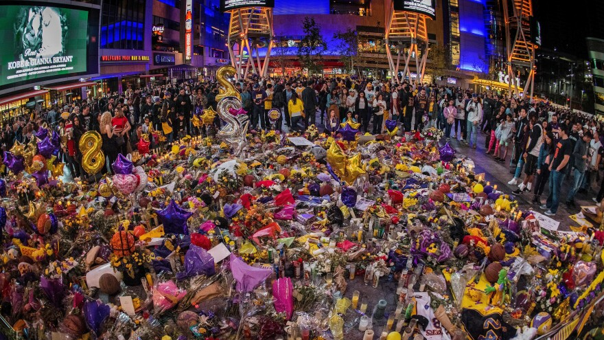 Lakers fans outside the Staples Center pay their respects, surrounding a memorial for Kobe Bryant, Gianna Bryant, and seven other victims killed last weekend in a helicopter accident.