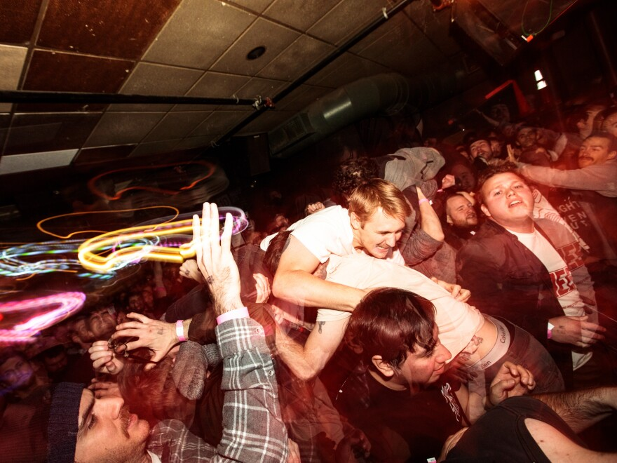 Crowdsurfing during a Drug Church show at Great Scott in 2018.