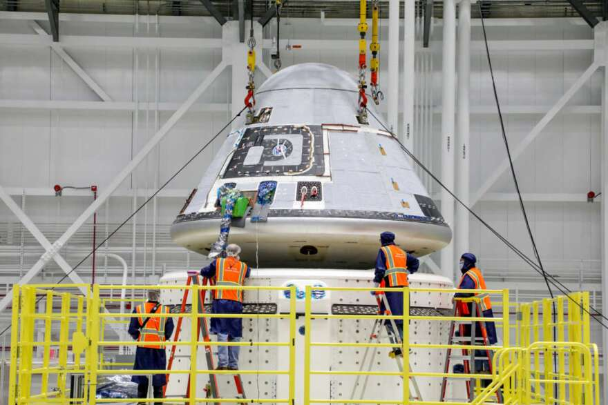 Technicians observe Boeing's Starliner crew module being placed on top of the service module in the Commercial Crew and Cargo Processing Facility at NASA's Kennedy Space Center in Florida on Jan. 14, 2021. Photo: Boeing / John Proferes