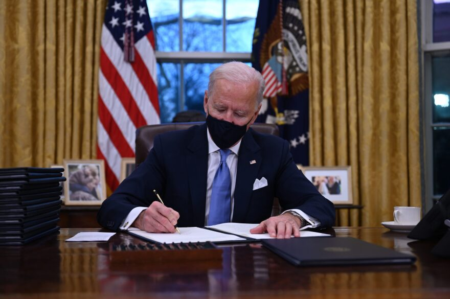 President Joe Biden sits in the Oval Office as he signs a series of orders at the White House in Washington, DC, after being sworn in at the US Capitol on Jan. 20, 2021. (Jim Watson/AFP via Getty Images)