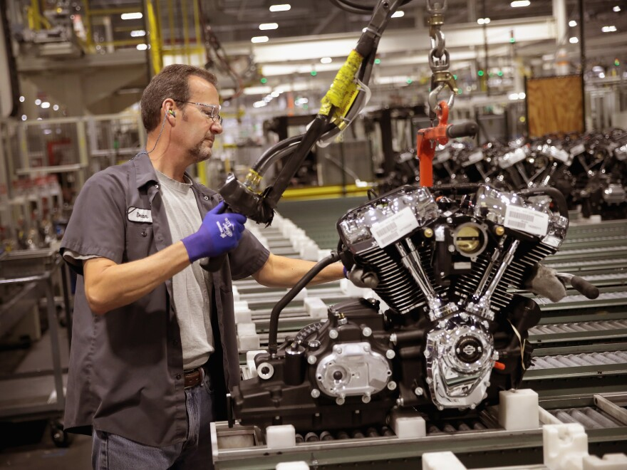 Harley-Davidson motorcycle engines are assembled at the company's plant in Menomonee Falls, Wis. Tariffs from the European Union are prompting the company to shift production of some motorcycles for the European market overseas.