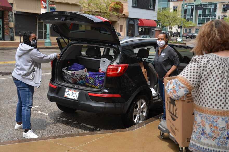 A photo of THRIVE unloading supplies for their dropoff.
