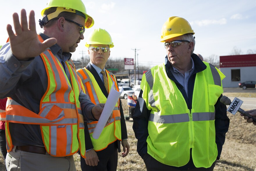 Gov. Mike Parson talks with an official from the Missouri Department of Transportation on Feb. 14, 2019. Parson stopped in Jefferson County to promote a bonding plan to repair bridges.