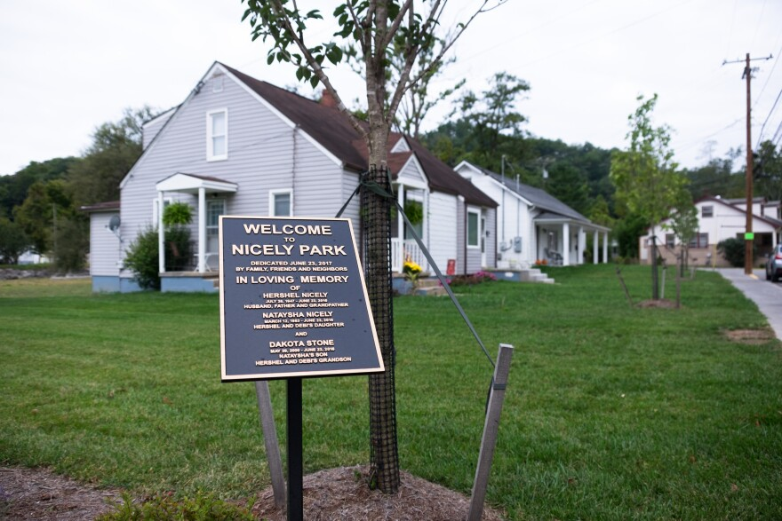 Creekside homes have been rebuilt to bare minimum elevation requirements adjacent to the lot where three generations of the Nicely family died when their house was torn from its foundation. Their lot has been turned into a memorial park.