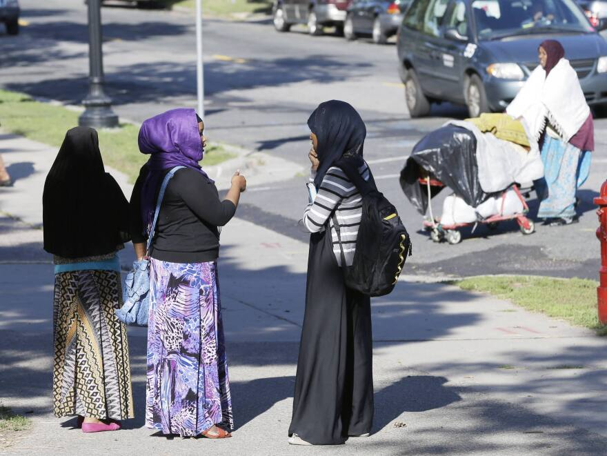 Members of the Somali community visit near a park in Minneapolis. The city is home to the nation's largest concentration of Somali Americans.