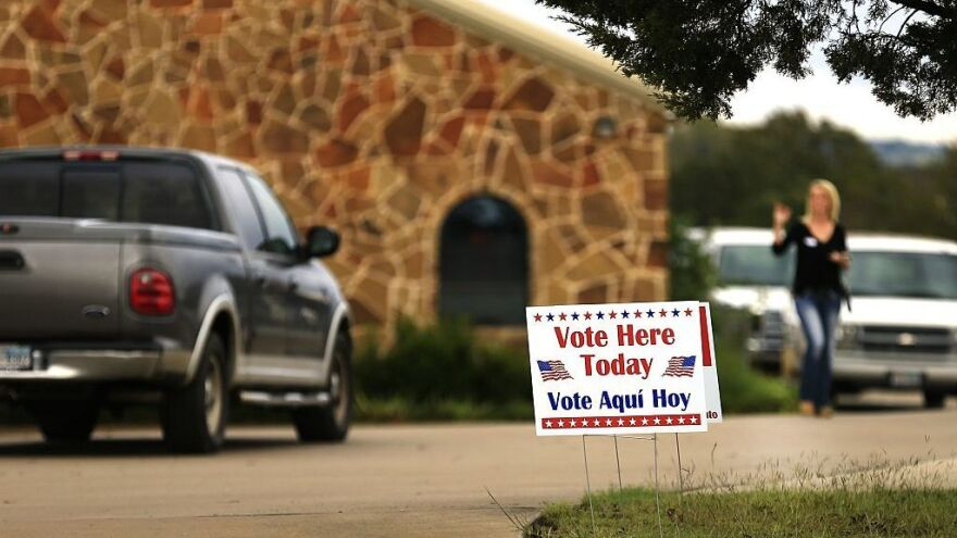 Voters arrive at a polling place November 8, 2016 in Brock, Texas.