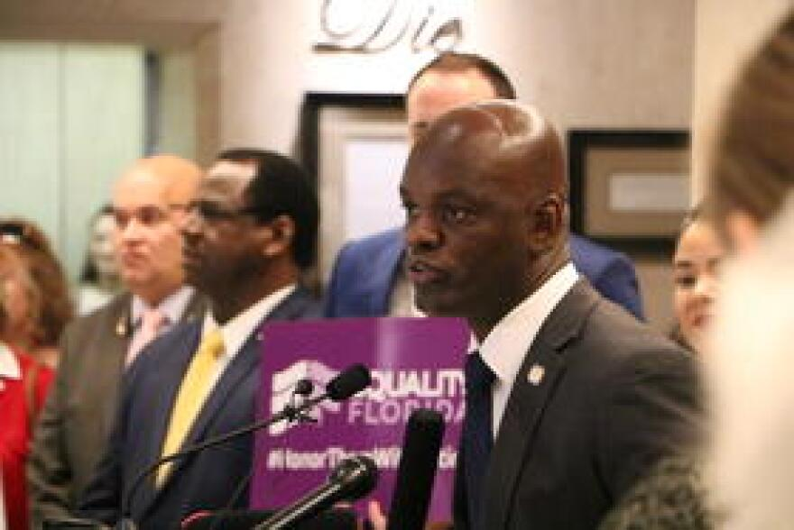 Florida House Minority Leader Kionne McGhee, alongside his colleagues Tuesday, lays out state Democrats' legislative plans to prevent gun violence.