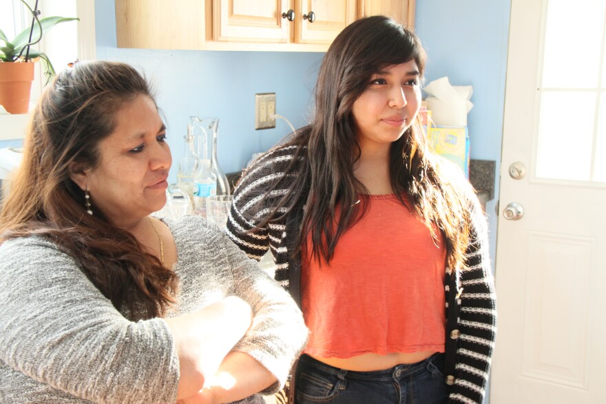 Nube and her middle daughter in their kitchen in Dayton latino
