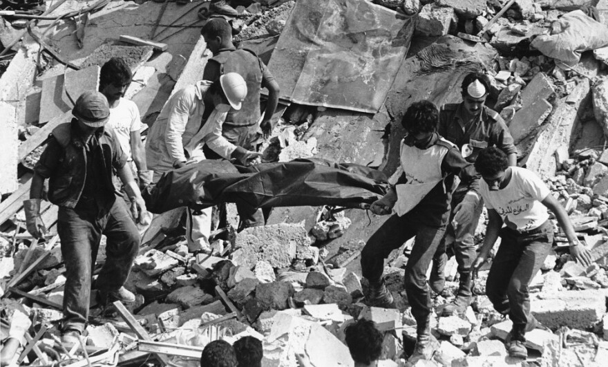 Rescue workers carry the body of a U.S. Marine killed in the Oct. 23, 1983, bombing of the Marine Operations Center in Beirut, Lebanon. The attack killed 241 American service members.