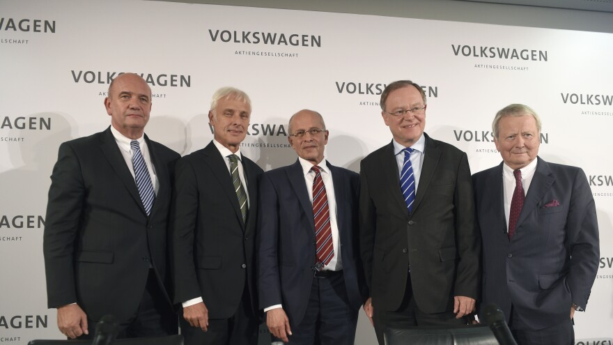 New Volkswagen CEO Matthias Mueller poses with Berthold Huber (third from right) acting head of the Supervisory board of Volkswagen, Stephan Weil (second from right) Prime Minister of Lower Saxony and member of the Supervisory board, Wolfgang Porsche (right) member of Supervisory board and Bernd Osterloh (left) head of Volkwagen's works council, at VW's headquarters in Germany on Friday.