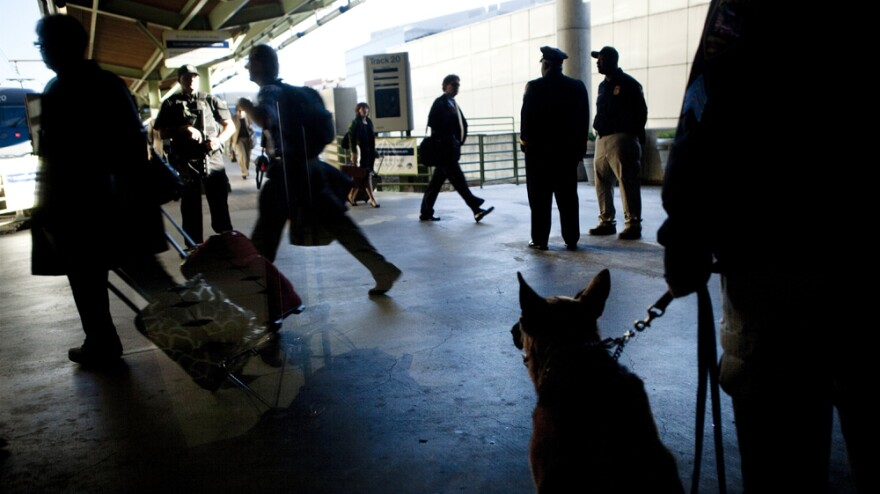 """An Amtrak Police K-9 watches while commuters depart for rush hour during """"Operation Railsafe"""" at Union Station in Washington, D.C., last October."""