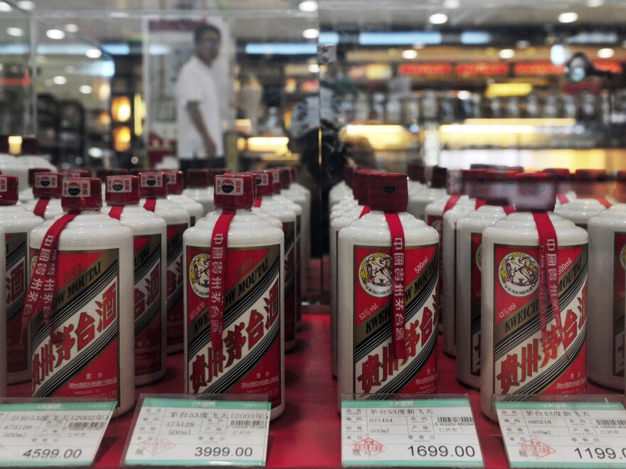 Bottles of Moutai baijiu liquor, seen here in a 2012 photo, have become scarce in many Chinese stores, even as spirits maker Kweichow Moutai has seen its stock soar in the past year.