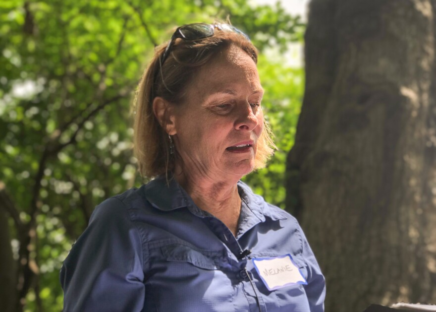 """Melanie Choukas-Bradley reads some nature-inspired poetry and quotes from renowned naturalist John Muir, as part of the walk. """"The air is as delicious to the lungs as nectar to the tongue,"""" Muir wrote. """"That could describe our day here now,"""" Choukas-Bradley says."""