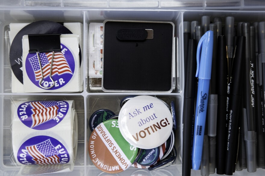Voting buttons and pens.