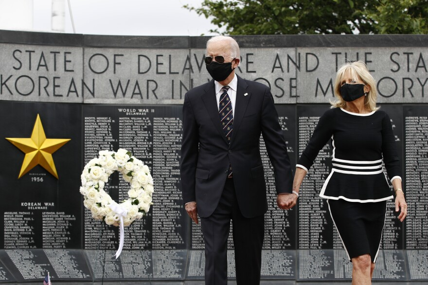 Former Vice President Joe Biden and Jill Biden depart after placing a wreath at the Delaware Memorial Bridge Veterans Memorial Park on Monday.