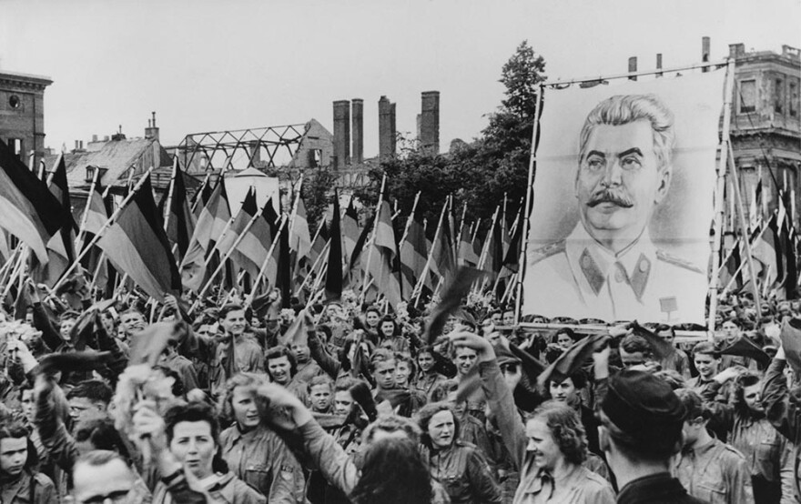 A Soviet-sponsored youth rally in the Lustgarten in Berlin, Germany, 1st June 1950. The youth carry huge portraits of Communist leaders such as Joseph Stalin (pictured). (FPG/Getty Images)