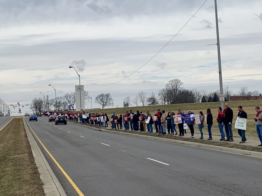 Dozens of students and community members joined members of the Wright State University's faculty union's picket line Monday.