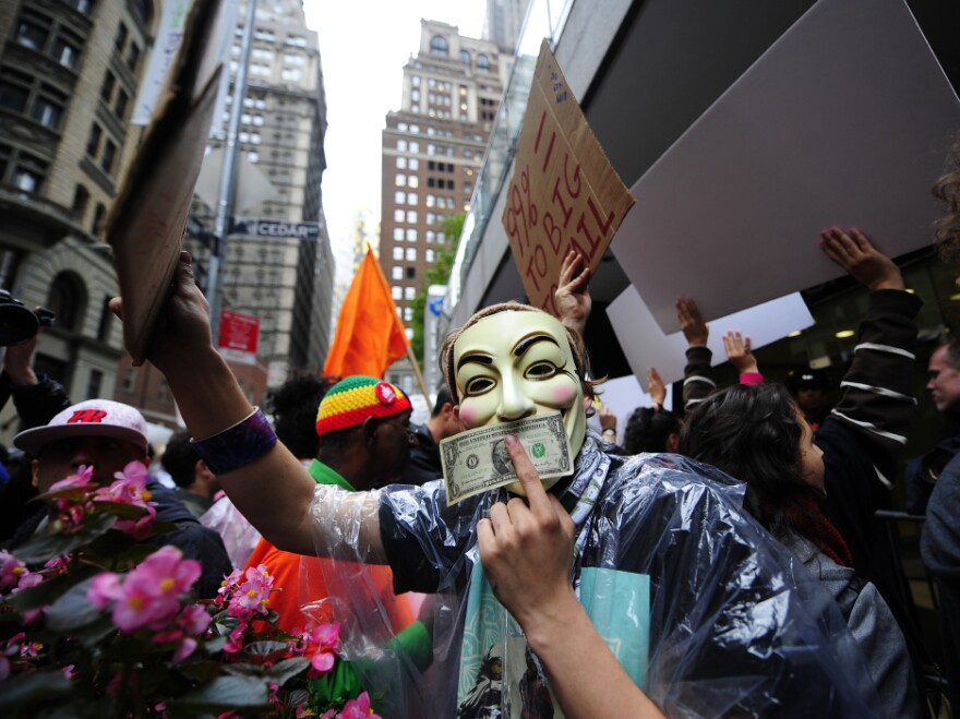 """Occupy Wall Street members stage a protest march near Wall Street in New York in October. Paul Taylor of the Pew Research Center says the movement has """"crystallized"""" the idea of economic disparity."""