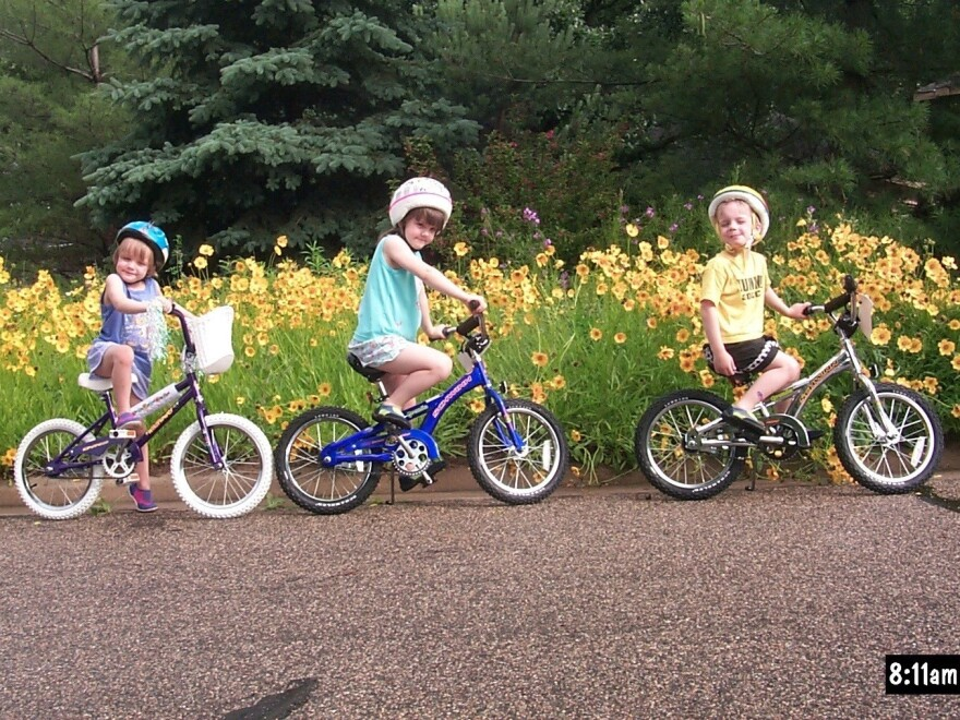 The Catlin triplets on bikes.
