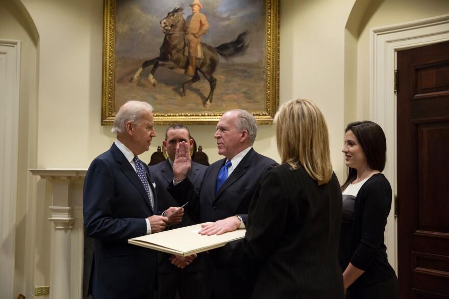 Vice President Joe Biden swears in CIA Director John Brennan in the Roosevelt Room of the White House on March 8, 2013.