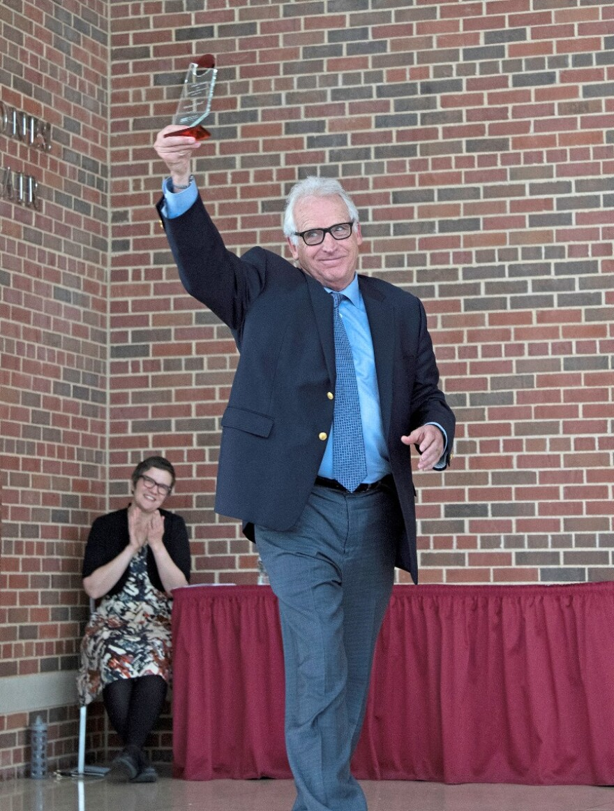 Michael Uthoff receiving an Award for Lifetime Achievement in the Arts from UMSL's College of Fine Arts and Communication in June 2015.