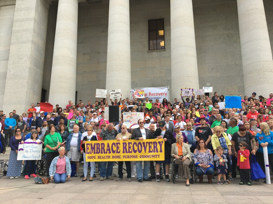 crowd at rally for recovery poses