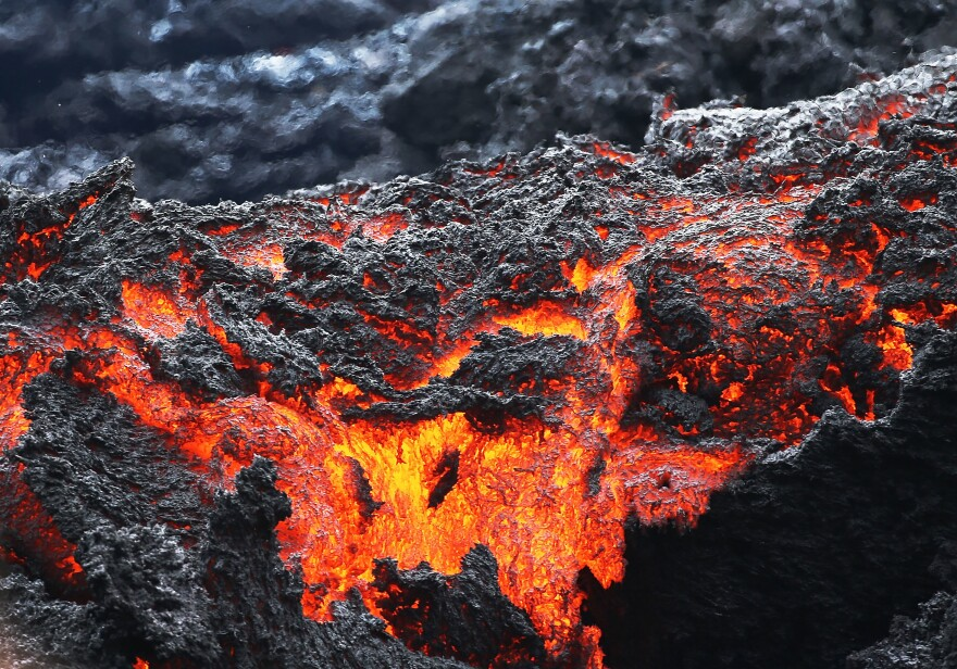 Lava flows at a lava fissure in the aftermath of eruptions from the Kilauea volcano on Hawaii's Big Island. The U.S. Geological Survey said a recent lowering of the lava lake at the volcano's Halemaumau crater has raised the potential for explosive eruptions at the volcano.