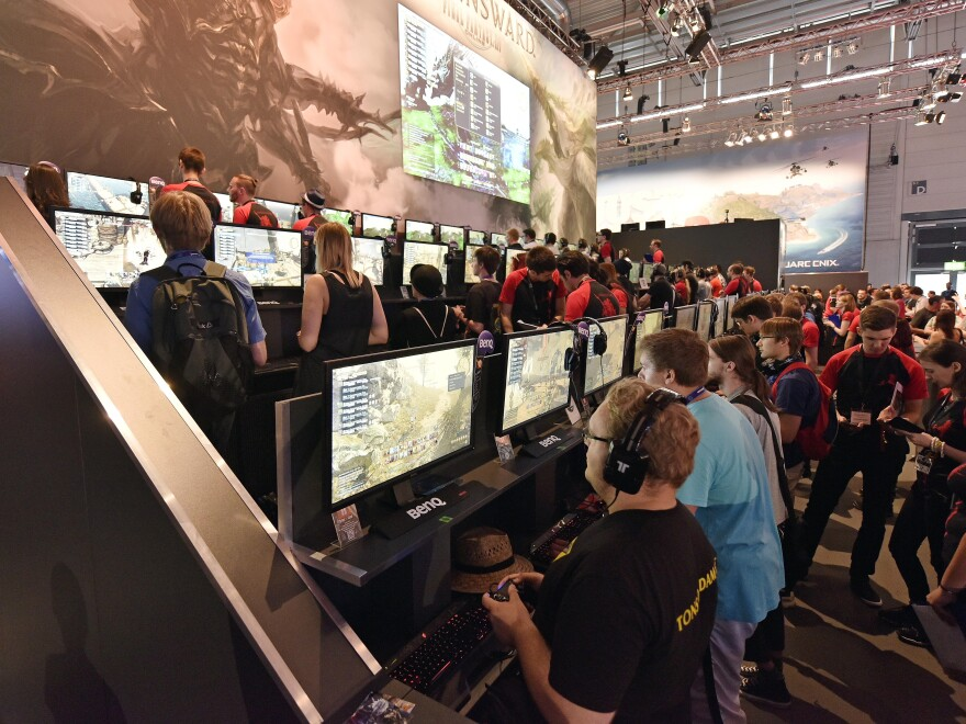 Participants play the latest video games at the gamescom computer game fair in Cologne, Germany, on Wednesday