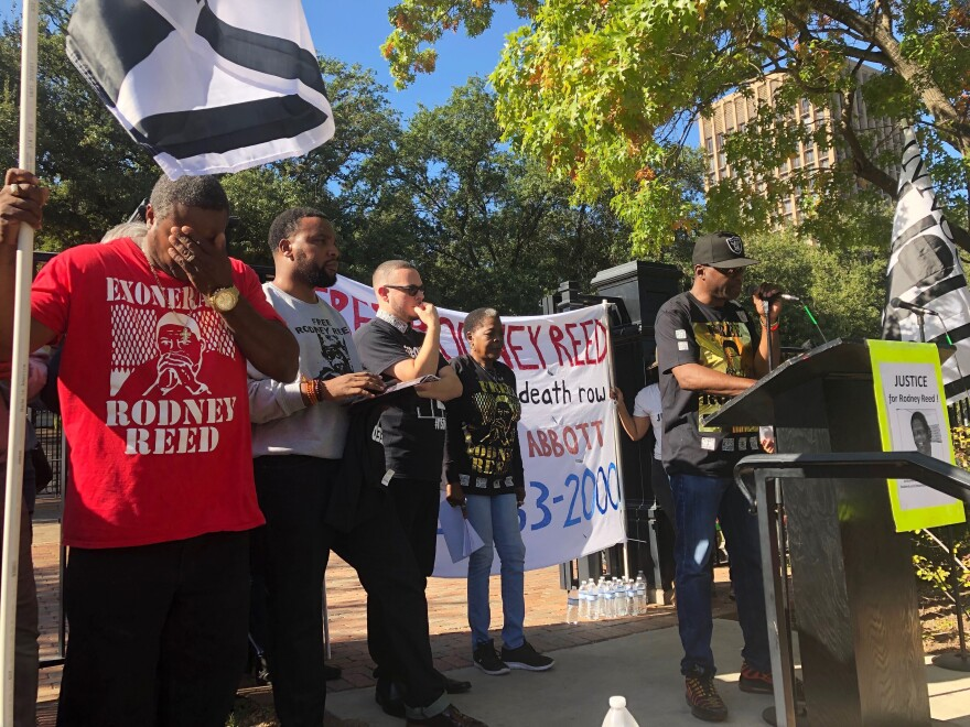 Edward Moore wipes his eyes while Rodrick Reed, brother of death row inmate Rodney Reed, rallies supporters outside the Texas governor's mansion in Austin Nov. 9, 2019.