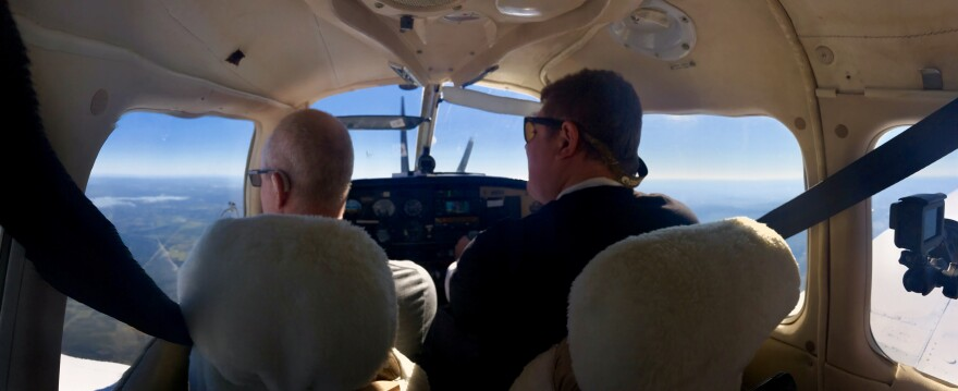 Jackson Busenbark (left) scans the skies over Texas with his friend Joe Kramlinger.