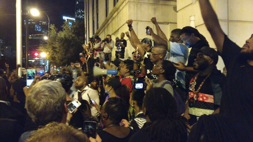 """Protesters gather outside of CMPD headquarters, chanting, """"release the tapes."""""""