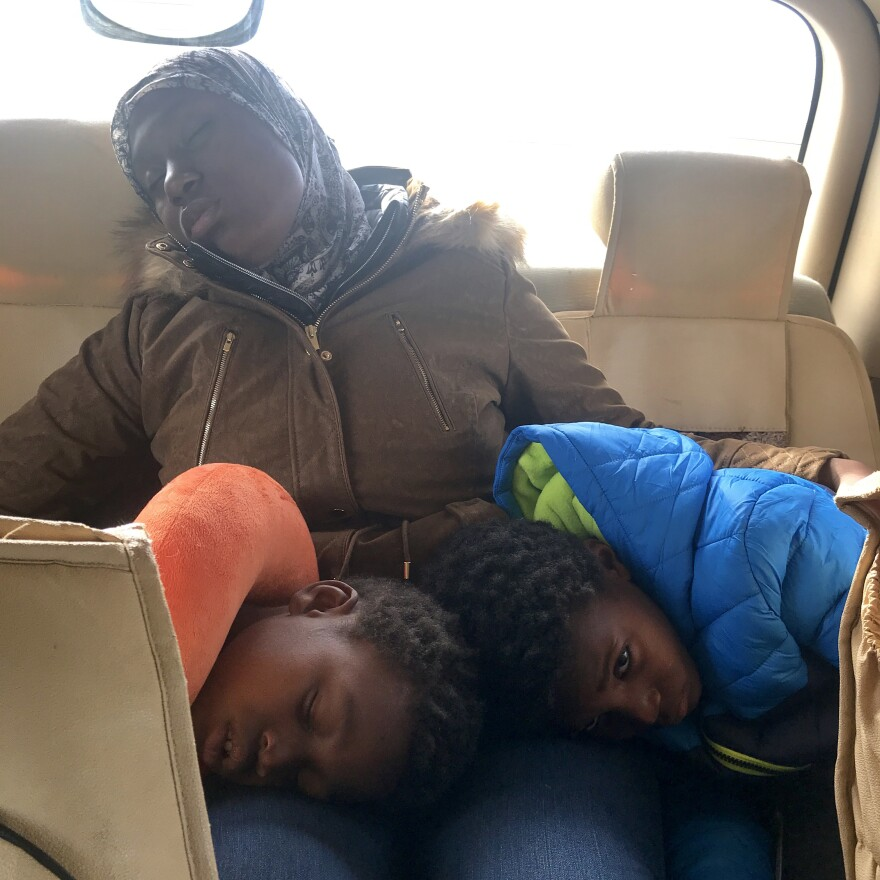 Felicia Perkins-Ferreira dozes with Mahmud, 11, and Ayyub, 7, on their journey out of Syria. This week marked the first time they have been together in four years.