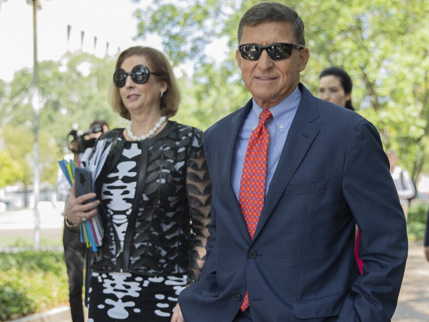 Michael Flynn, President Trump's former national security adviser, leaves federal court with lawyer Sidney Powell in September 2019.