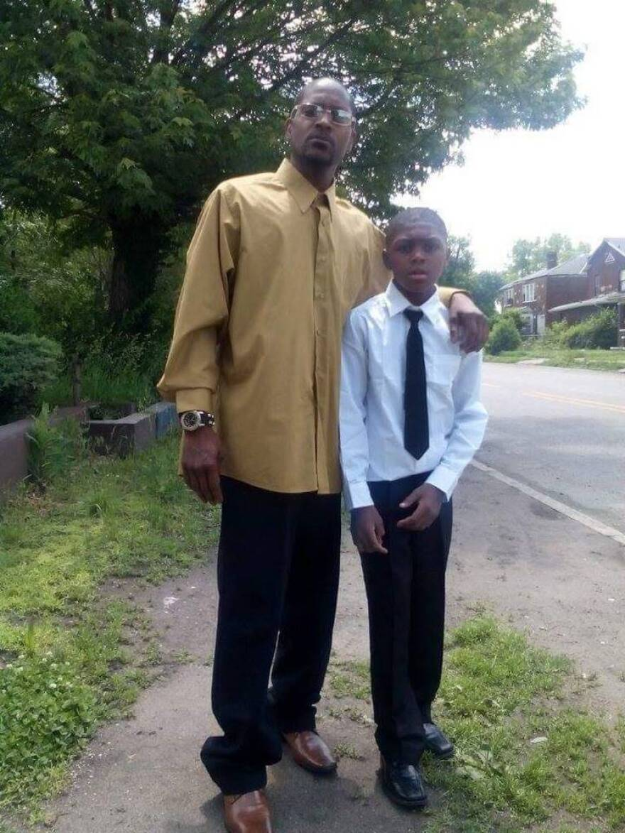 Michael Henderson Sr. and his son, Michael Henderson III, when he was in sixth grade. Henderson III was 15 when he was shot and killed in East St. Louis on June 25.
