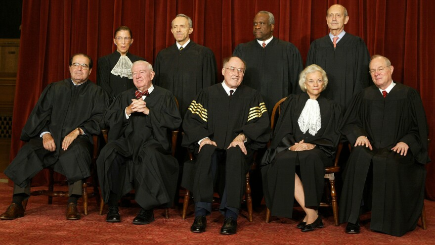 O'Connor and Rehnquist are pictured with the other Supreme Court justices for a photo in 2003.
