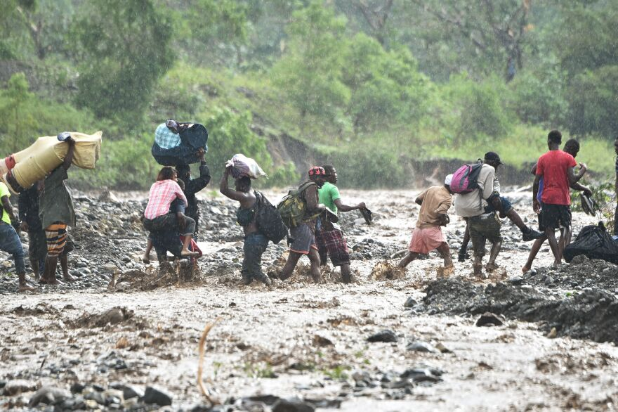 A photo taken Wednesday shows the river La Digue southwest of the capital, Port-au-Prince, where the storm caused the collapse of a bridge on the only road linking the capital to Haiti's southwest.