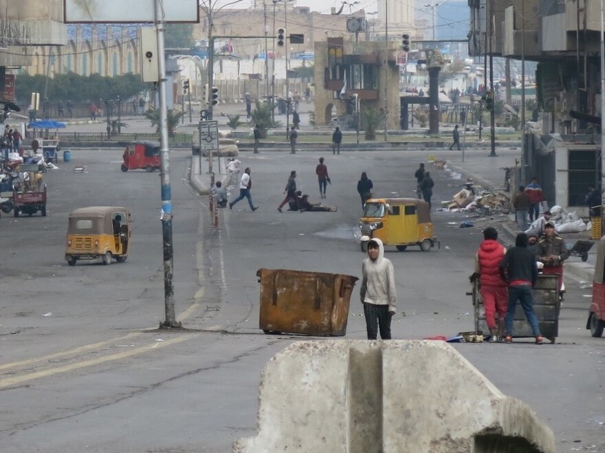 Security forces burned medical tents and fired live bullets and tear gas to drive protesters from bridges and streets near Tahrir Square in Baghdad on Saturday.
