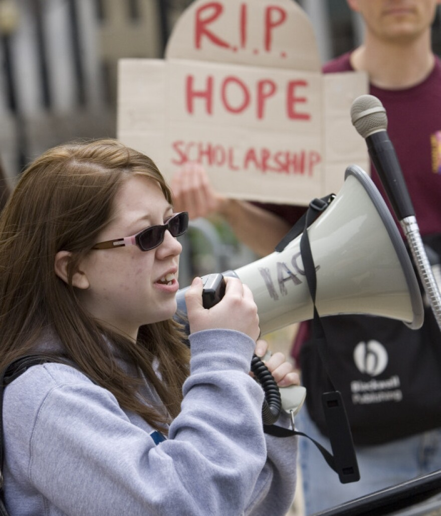 Georgia State University student Heather Sparks tells a crowd how she benefited from the HOPE scholarship during a March 8 demonstration outside the Georgia state capitol.