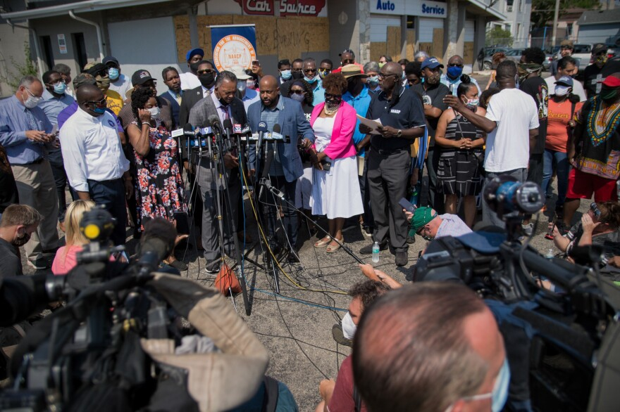 The Rev. Jesse Jackson spoke at a press briefing Thursday in Kenosha, Wis., in the parking lot of Bert and Rudy's Auto Service, where two protesters were shot and killed Tuesday night.