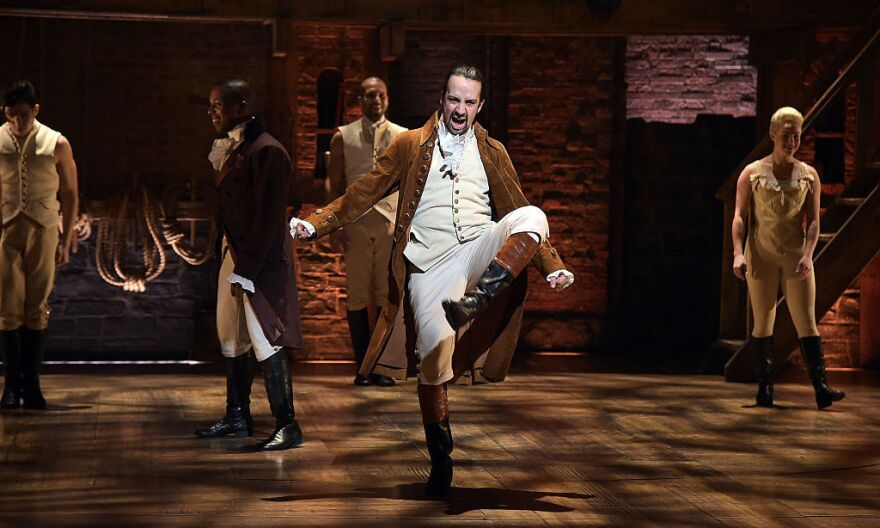 Actor and composer Lin-Manuel Miranda (center) performs on stage during a rehearsal of <em>Hamilton</em> ahead of the Grammy Awards in February in New York City.