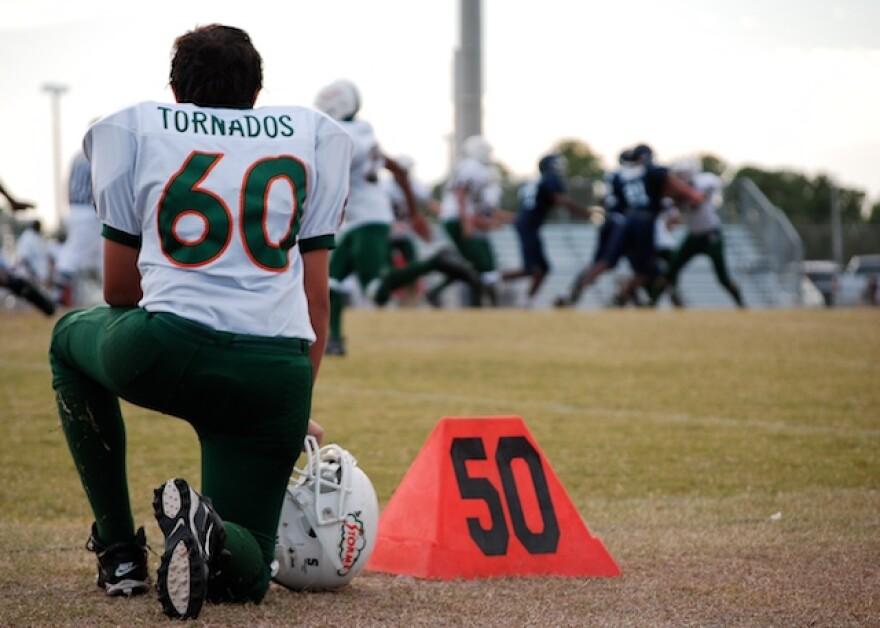 football_kneeling.jpg