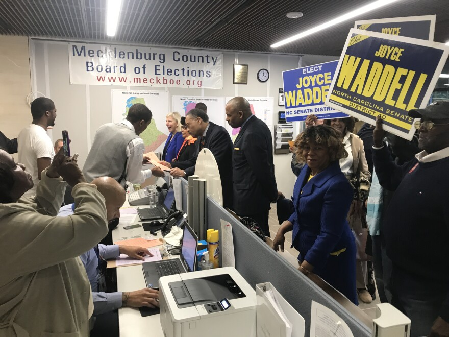 Candidates and their supporters pack the Mecklenburg County Board of Elections on Monday, the first day of the filing period.