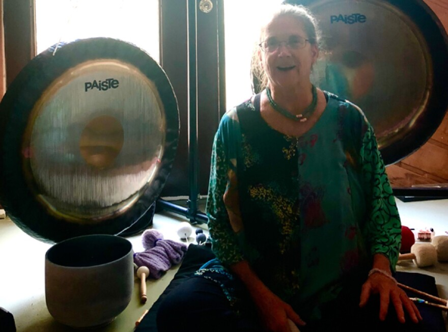 Jodi Roberts with two of her 9 gongs, sound therapy