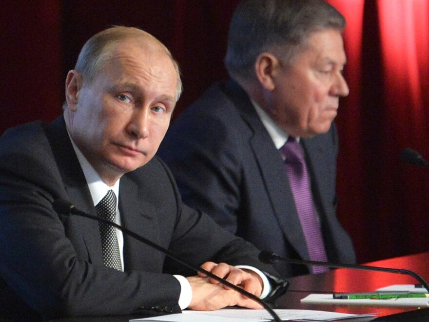 """Russian President Vladimir Putin (left) attends an Interior Ministry meeting Wednesday in Moscow. He condemned the death of Boris Nemtsov, saying it was a """"disgrace"""" to Russia."""