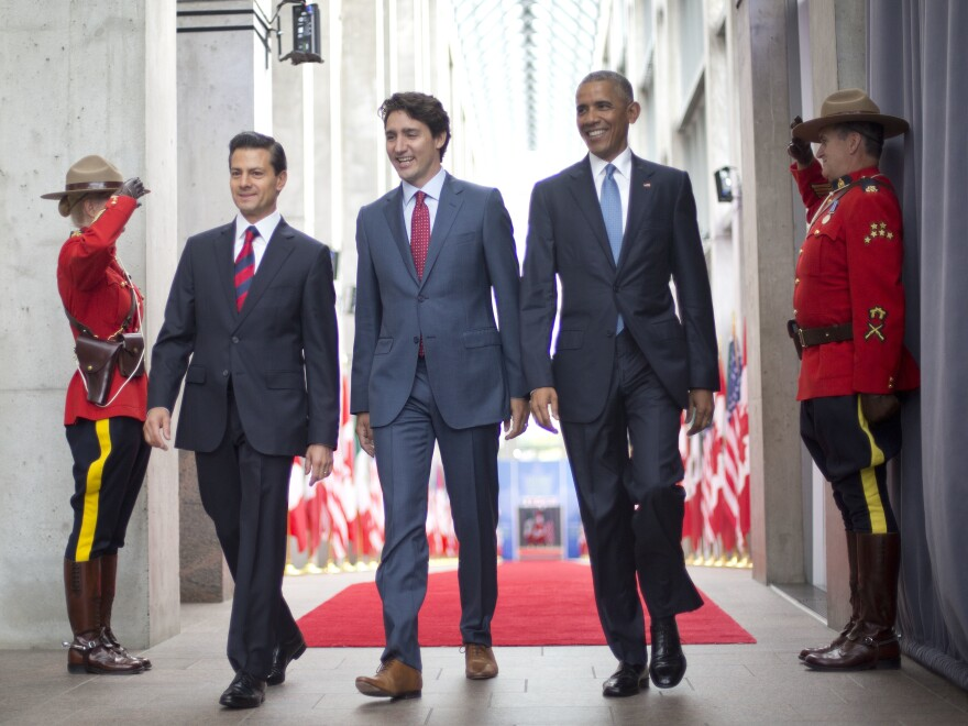 President Barack Obama walks with Canadian Prime Minister Justin Trudeau and Mexican President Enrique Pena Neito at the National Gallery of Canada in Ottawa, Canada, Wednesday, June 29, 2016.
