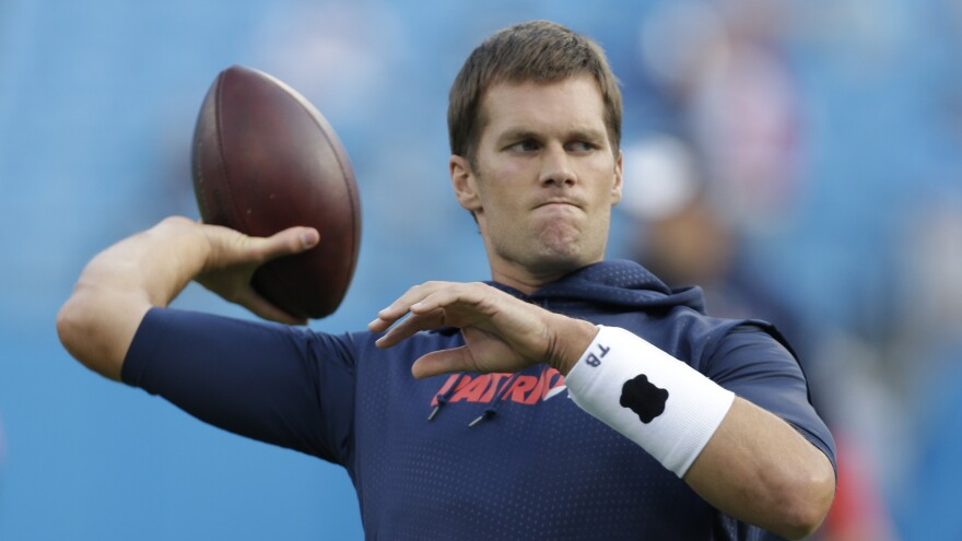 New England Patriots' Tom Brady warms up before a preseason game against the Carolina Panthers on Aug. 28.