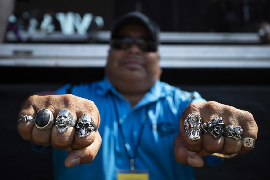 Security guard Jimmy G. shows off a bunch of skull rings