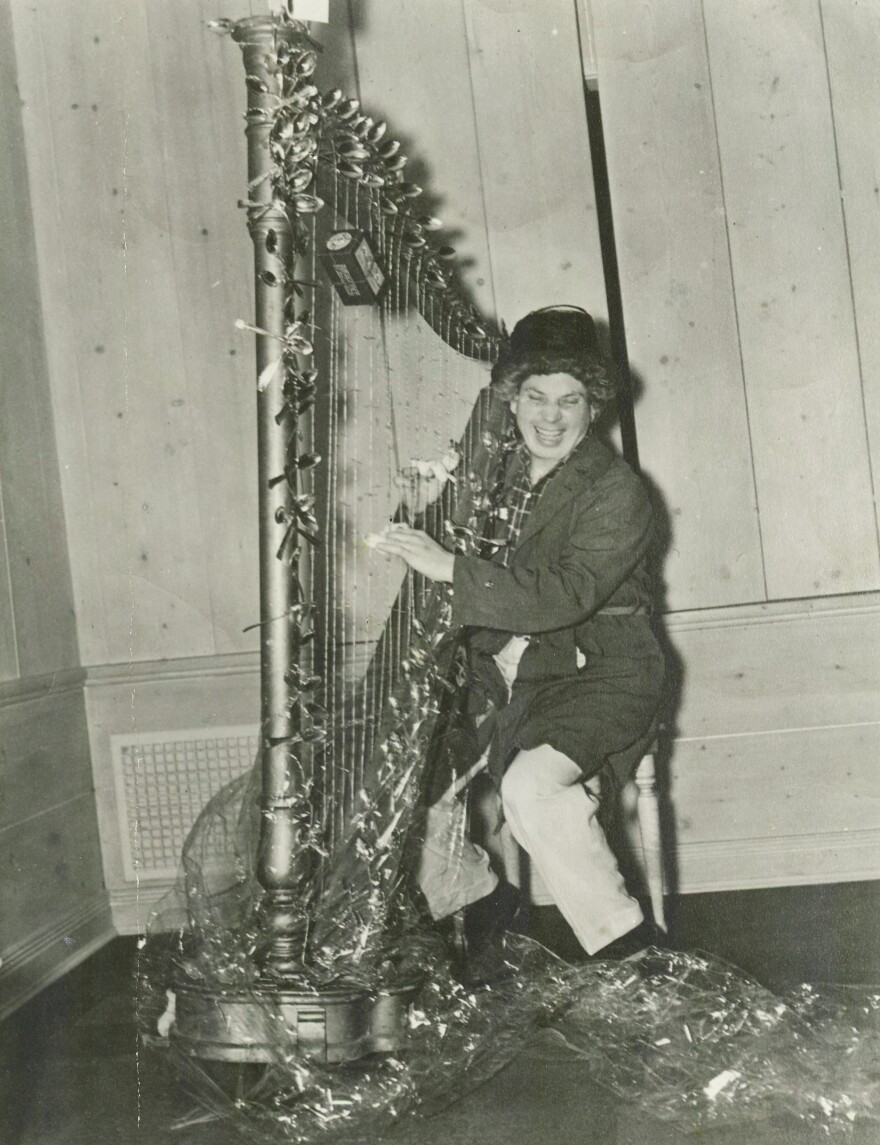 Harpo Marx with the surrealist harp sent to him by Salvador Dalí.