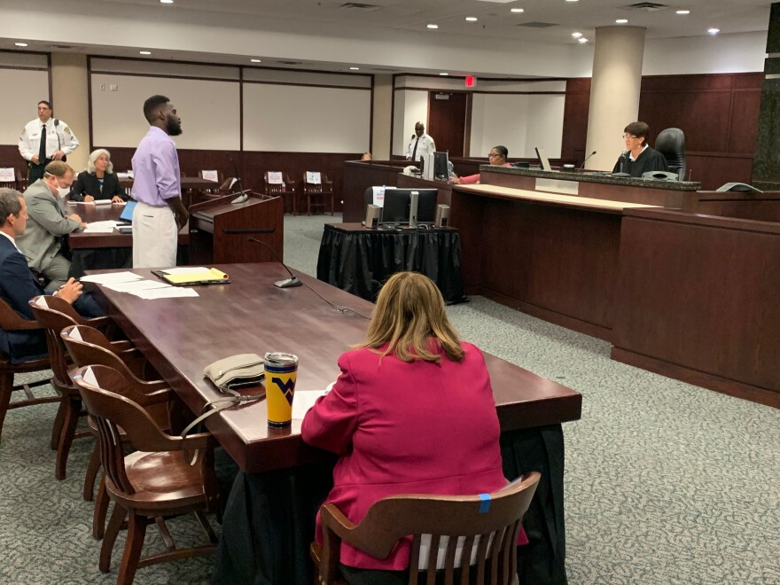 Courtroom scene with Judge Catlin, Eugene Williams and others.