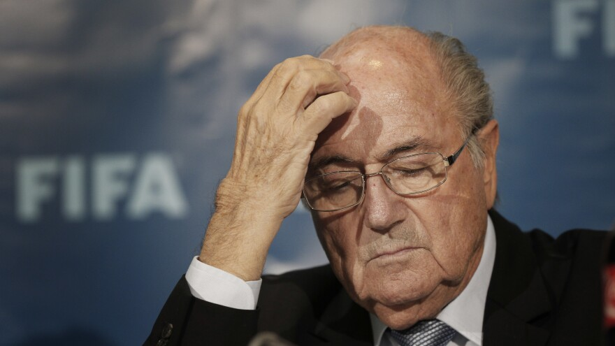 FIFA President Sepp Blatter, pictured in 2014, and two other officials are said to have paid themselves tens of millions of dollars though contract amendments over a five-year period.